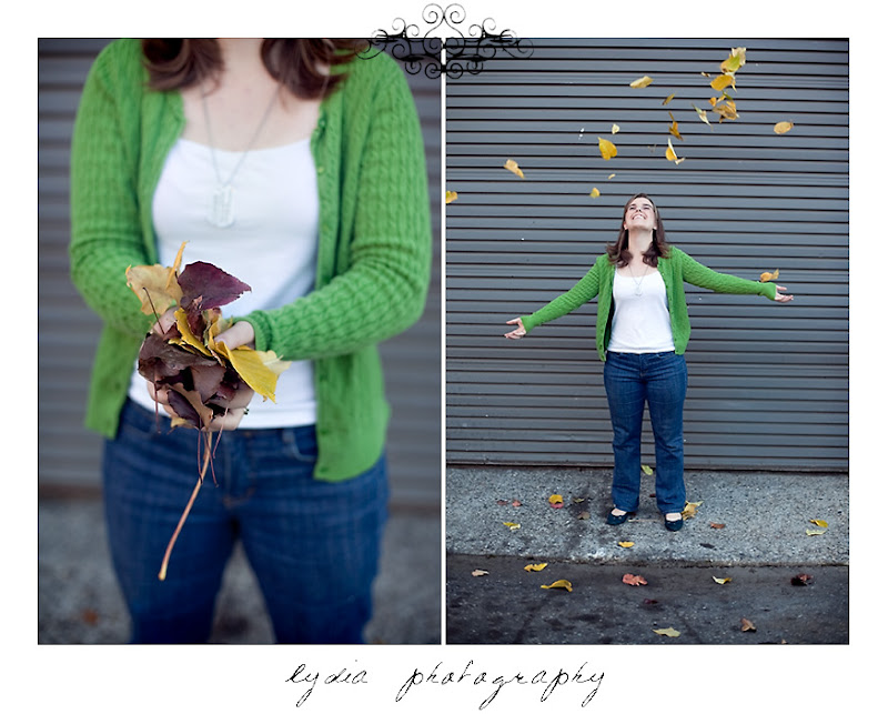 Emi throwing fall leaves for her senior portraits at Colfax California