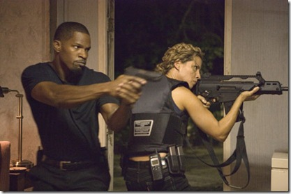 JAMIE FOXX as Detective Ricardo Tubbs and ELIZABETH RODRIGUEZ as Gina Callabrese prepare to take down members of the Aryan Brotherhood in ?Miami Vice?, the feature film crime drama that liberates what is adult, dangerous and alluring about working deeply undercover.  ?Miami Vice? opens on July 28, 2006.