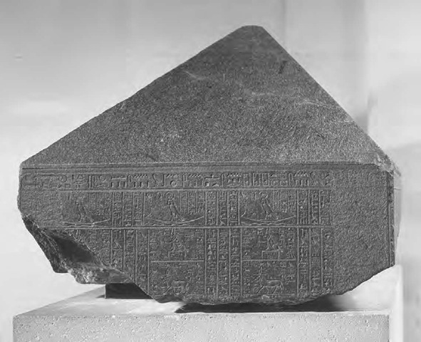 "Inscribed gray granite fragment from the ""Naos of the Decades,"" an Egyptian shrine dating to the fourth century B.C.E., part of a text giving astrological prognostications associated with different decades"