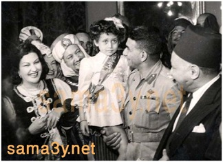 President Naguib holding the future star