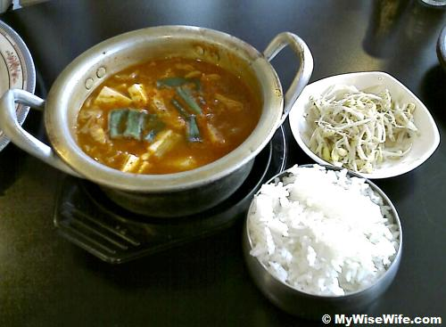 Kimchi Soup, steamed rice and side dishes (bean sprouts)