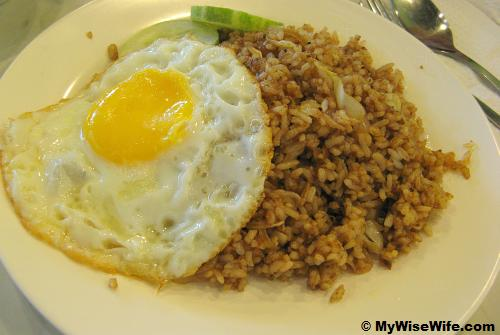 Salted fish fried rice with a bull-eyed egg and cucumber