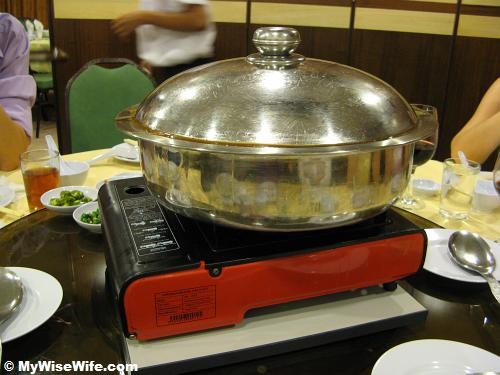 A huge basin on gas stove