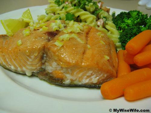 Baked Salmon served with grated lemon rind