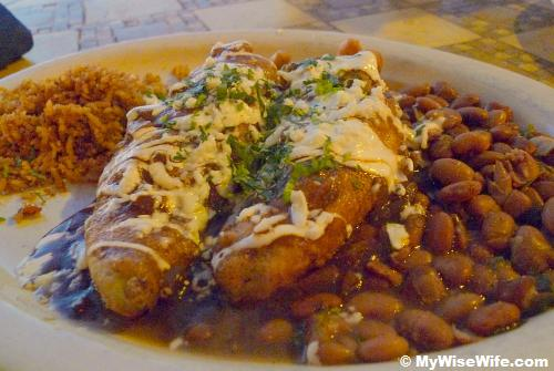 Pulled Pork Rellenos - braised prok stuffed in Tecate beer-battered Anaheim chiles, fried golden brown and served with Spanish rice.