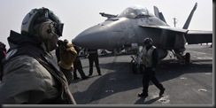 November 29, shipboard sailors ready to move to the Super Hornet aircraft catapult