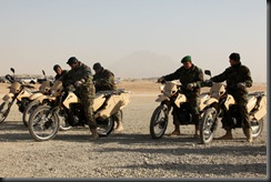 Soldiers of the Afghan National Army is practiced in driving a motorcycle.