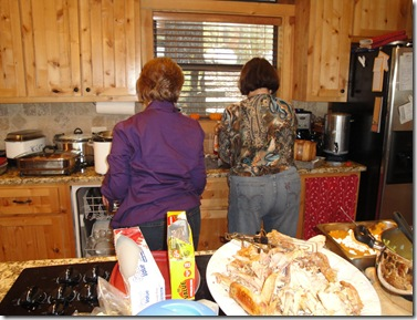 9.  Mom and Lynn cleaning