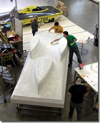 Abraham Poot, Nick Killoran, and Joe Mydosh work on the Sunseeker body