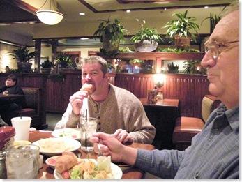 Rick enjoying his croissant at Cheddar's