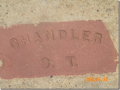 a brick set in the sidewalk