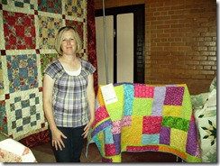 Jodi S with daughter's quilt