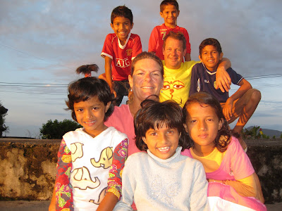 Marc Osborn and his friend Brooke Wilson with their six Nepali children.