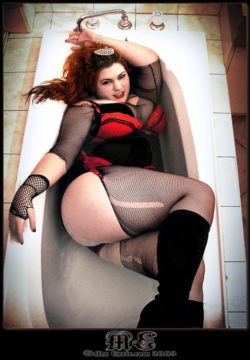 a sexy woman wearing lingerie in the bathtub