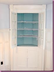 corner cabinet doors open