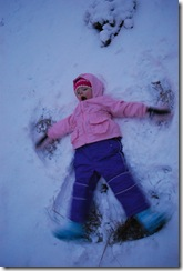 Her first snow angel.