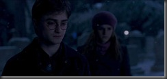 800px-A_teary_Harry_Potter_with_Hermione_Granger_at_Godric's_Hollow