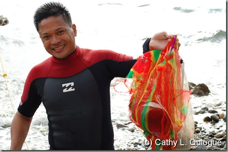 Dive master Butch Javier with his finds