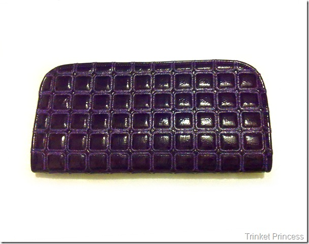 violetquilted patent clutch bag