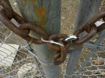 Chain secured with a padlock and cable tie