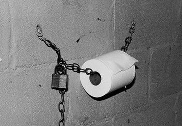 Toilet roll chained and padlocked to wall