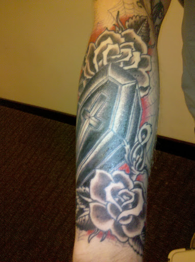 what are peoples thought about having black and grey tattoos and colored