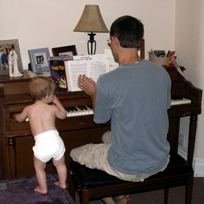 Elaine 10 months playing piano with Daddy