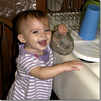 Elaine 10 months washing dishes