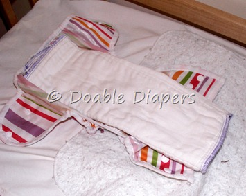 Prefold diaper trifolded in cover