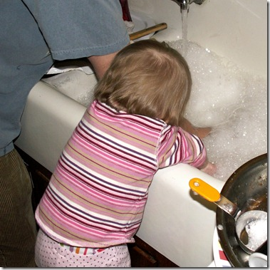 Elaine doing dishes with daddy