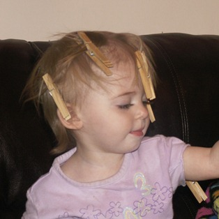 Elaine with clothespins in hair