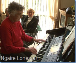 Ngaire Lonergan enjoying the Clavinova whilst Neil Adams and Doreen Comyns watch-on