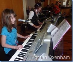 Jordan Oxenham, a student of Carole Littlejohn, played two pieces on the piano and then one piece on the Tyros keyboard accompanied by Carole Littlejohn on a Korg Pa1X keyboard