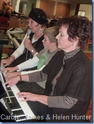 A Trio on the one piano. Here we see Carole singing and playing along with her student James Hunter with 'mum' Helen Hunter joining-in the fun!