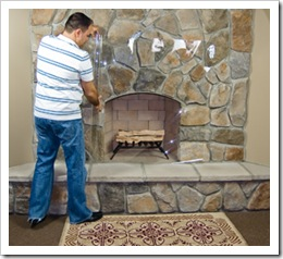 Unrolling the plastic over the fireplace