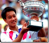 Michael Chang holding the French Open trophy