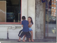 Siblings fighting waiting for their mum in the shop (they were really going for it)