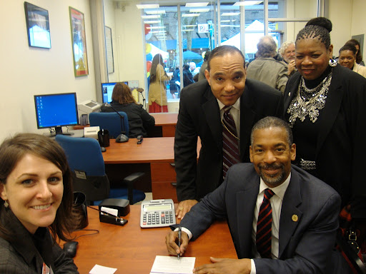 ERDA FCU CEO Carmen Simon and Bishop Mitchell Taylor open a credit union account for New York City Housing Authority Chairman John Rhea.