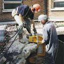 concrete slab being broken piece by piece usng the 'crunching' method