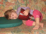 Mollie fell asleep while holding this drum