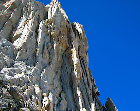 Tom cruising up the steep flakes on pitch 2