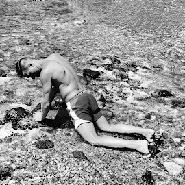 curves in the river by Francesca Pierini - People Portraits of Men ( potrait, black and white, stone, man, river )