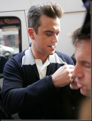#3999115 Robbie Williams seen outside the Royal Albert Hall today having a cigarette break during rehearsals for the BBC Children in Need concert in London, UK on November 12, 2009.