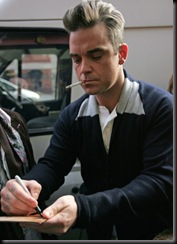 #3999117 Robbie Williams seen outside the Royal Albert Hall today having a cigarette break during rehearsals for the BBC Children in Need concert in London, UK on November 12, 2009.
