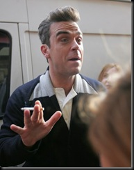 #3999118 Robbie Williams seen outside the Royal Albert Hall today having a cigarette break during rehearsals for the BBC Children in Need concert in London, UK on November 12, 2009.