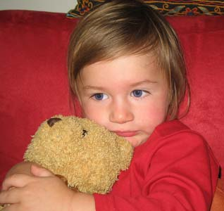 Girl Holding Her Teddy Bear