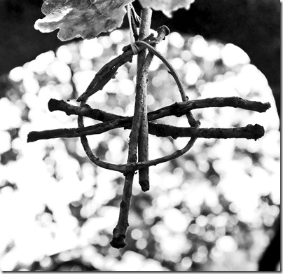 handmade pagan symbol hanging on tree