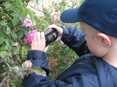 Boy taking picture with digital camera