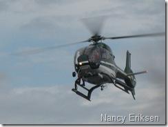 Helikopter som fotograferer