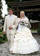 Groom and bride outdoors in wedding day